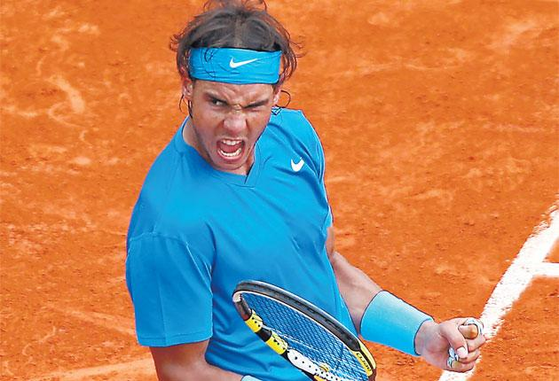 Rafael Nadal celebrates during the French Open final against Roger Federer on Sunday