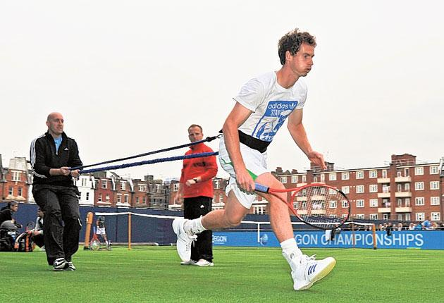 Andy Murray tests his injured ankle as the grass-court season opened with rain delays. The Scot is confident of playing in the doubles at Queen's today