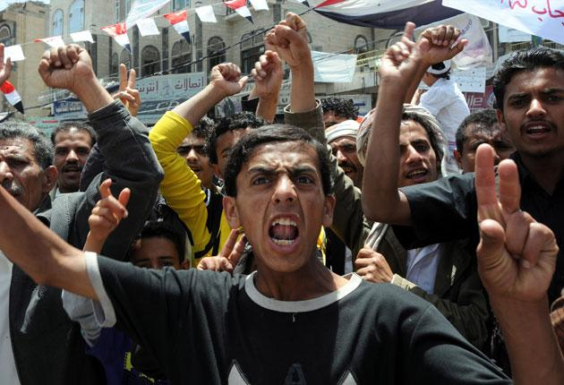 Anti-government protesters celebrate the departure of President Saleh in Sanaa yesterday