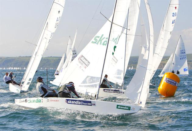 Iain Percy (left) and Andrew Simpson compete on Olympic waters in the Sail for Gold regatta in Weymouth