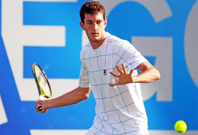James Ward hits a return to Stanislas Wawrinka at Queen's yesterday