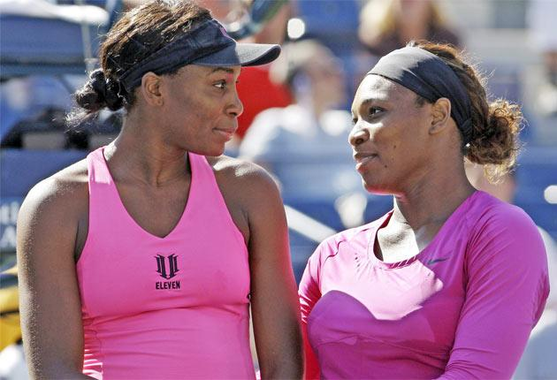 Venus (left) and Serena Williams could meet in the first round at Eastbourne due to their low world rankings