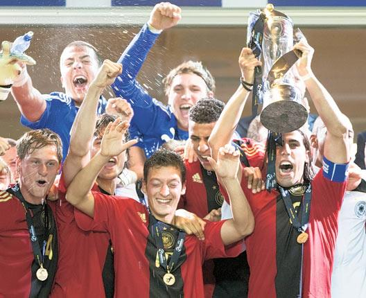 Sami Khedira lifts the Under-21 European Championship trophy in 2009. The team also featured Mezut Ozil (centre), Manuel Neuer (top centre) and Jérôme Boateng who all helped knock out England at the World Cup in South Africa only a year later