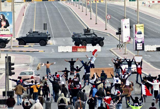 Protesters confront the military near Manama's Pearl Square in March