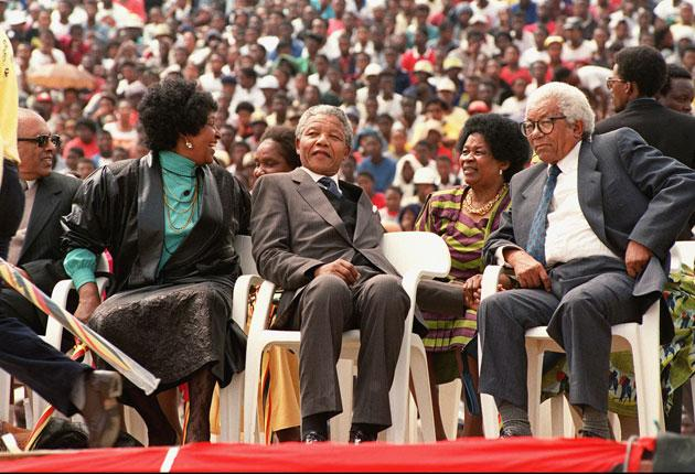 Sisulu, third left, with Winnie and Nelson Mandela and her husband Walter in Soccer City stadium in 1990