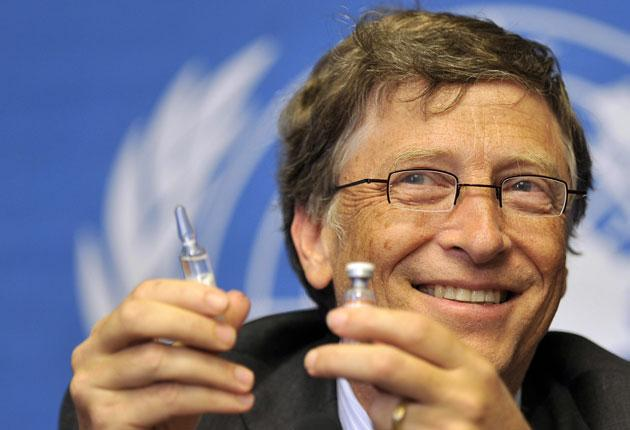 Microsoft founder Bill Gates shows vaccine during a press conference