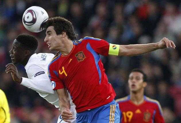 England goalscorer Danny Welbeck  (left) is challenged by Spain's Javi Martinez in the 1-1 draw