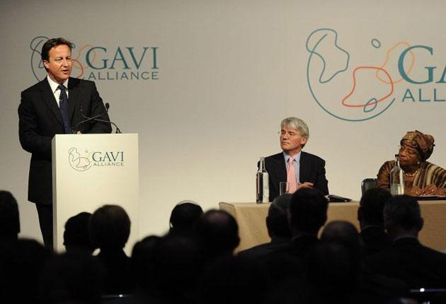 David Cameron speaks as (from left to right) Andrew Mitchell and the  President of  Liberia Ellen Johnson-Sirleaf look on