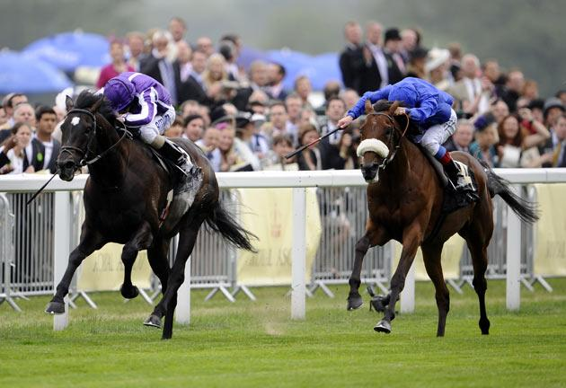 Frankie Dettori riding Rewilding (right) to victory in the Prince of Wales's Stakes from So You Think