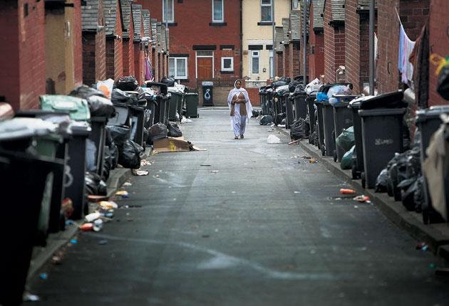 Tip off: A typical street in Leeds during the 2009 binmen strike