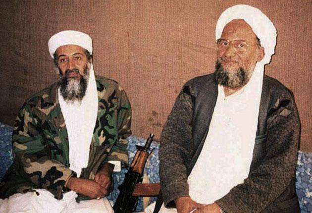 Ayman al-Zawahiri, right, sits with Osama bin Laden, in 2001