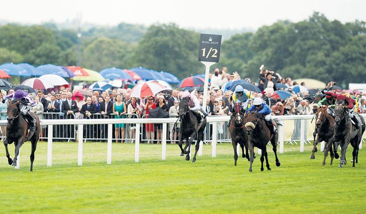 Jamie Spencer steers Fame And Glory (left) to Gold Cup glory during Ladies' Day at Royal Ascot