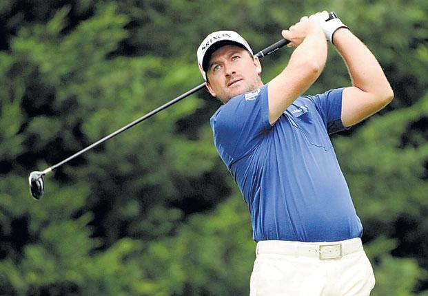 Northern Ireland's Graeme McDowell hits his tee shot on the fifth hole at Congressional yesterday