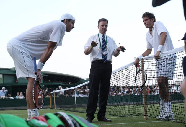 American John Isner, left, and Frenchman Nicolas Mahut during their epic encounter at Wimbledon, which has been commemorated with a plaque on Court 18