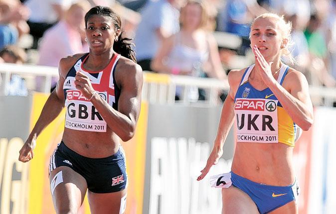 Shana Cox tries to chase down 400m winner Antonina Yefremova of Ukraine