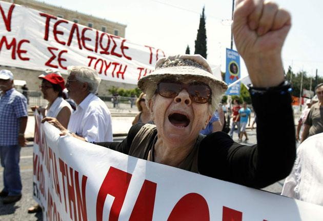 A member of the Greek communist party protesting in Athens yesterday