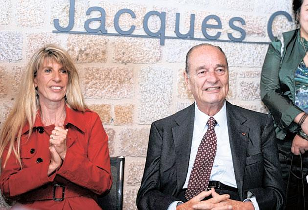 Political flirtation: Jaques Chirac fussed over sitting next to local councillor Sophie Dessus, before being told off by his wife, Bernadette