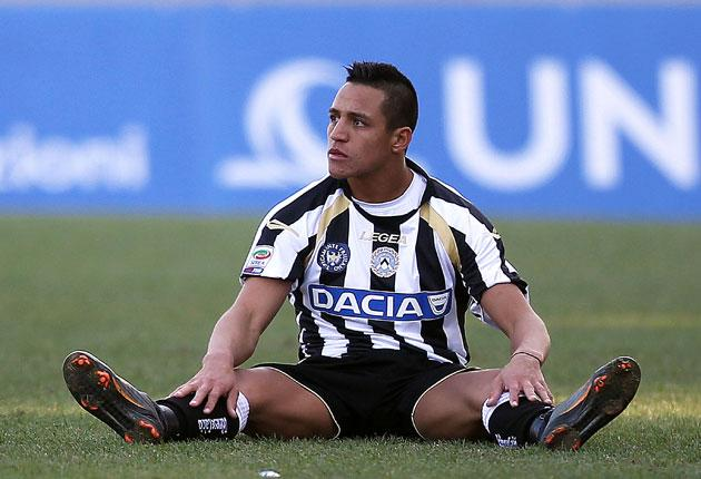 Alexis Sanchez hits the deck during a Serie A match for Udinese