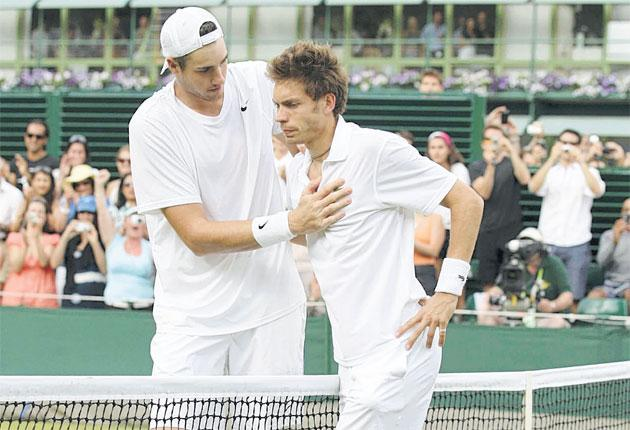 John Isner (left) and Nicolas Mahut after their record-breaking match at Wimbledon last year