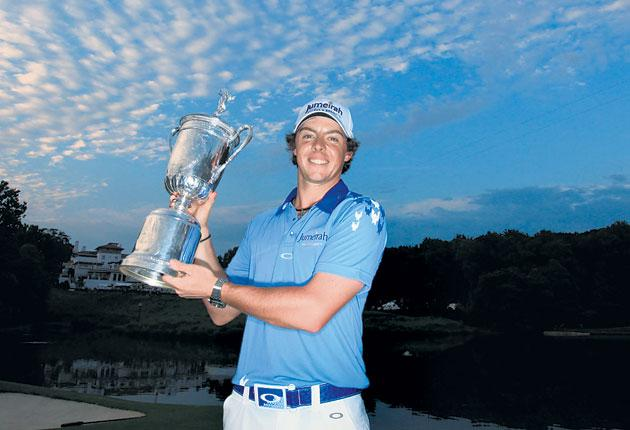Rory McIlroy poses with the trophy after his eight-stroke victory at the US Open