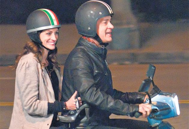 Wheels of fortune: Julia Roberts and Tom Hanks explore the fun side of having to sell the car in Larry Crowne