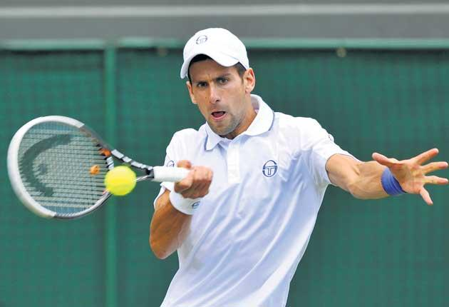 Novak Djokovic plays a forehand during his straight-sets win over Kevin Anderson