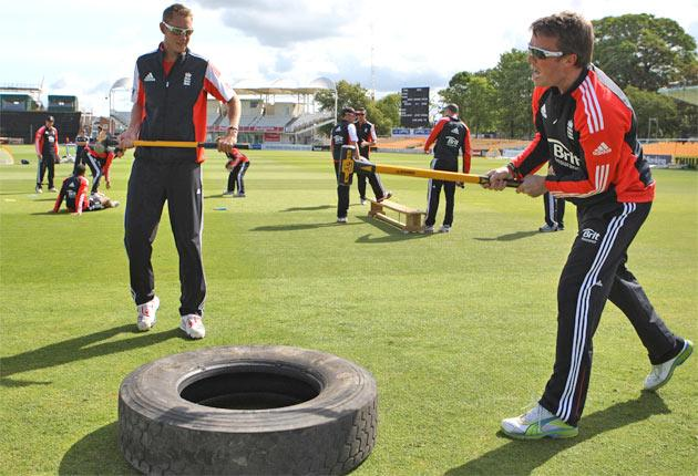 England Twenty20 captain Stuart Broad (left) and Graeme Swann hit a lorry tyre with mallets during a strengthening exercise at the County Ground in Bristol yesterday. Broad leads the side for the first time today