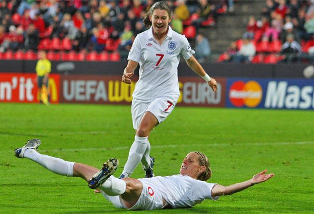 Karen Carney rushes to congratulate Kelly Smith after another goal for the England striker. The success of the women's team at the World Cup starting tomorrow will be crucial to the domestic game