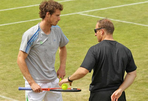 Andy Murray on the practice courts with fitness trainer Matthew Little