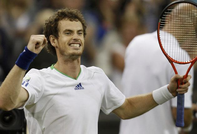 Andy Murray smiles broadly after victory last night