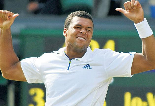 Jo-Wilfried Tsonga is ecstatic after his win over Roger Federer
