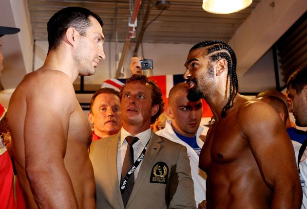Wladimir Klitschko (left) and David Haye square up during yesterday's Hamburg weigh-in