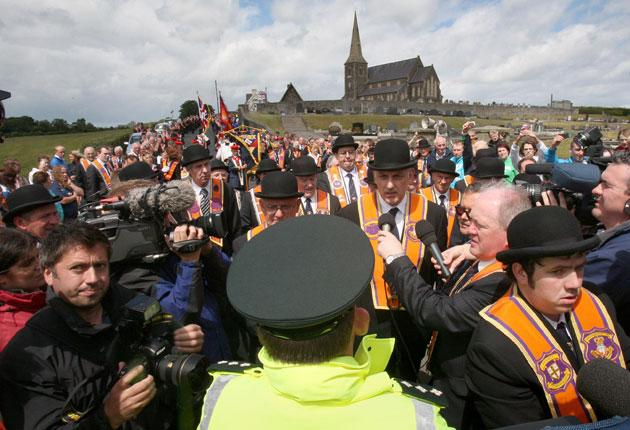 Orangemen on the march at Drumcree Bridge last year