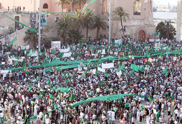 Libyans listen to yesterday's speech by Colonel Gaddafi. The photograph was taken on a government organised tour.