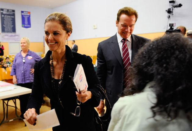 Maria Shriver and Arnold Schwarzenegger voting in mid-term elections last year