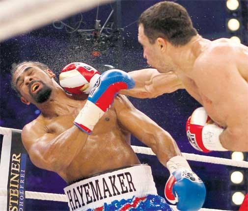 David Haye is caught by a right hook from Wladimir Klitschko in Hamburg last night