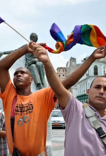 Flying the flag: participants in Cuba's first ever pride march last week