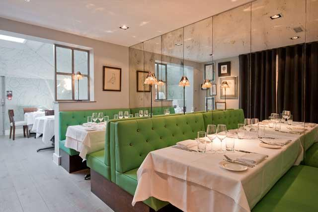 Effortfully chic: The restaurant features green banquettes, artfully distressed mirrors and peculiar lamps