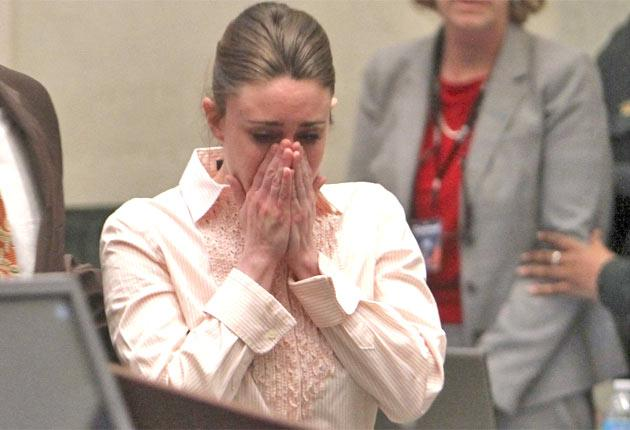Casey Anthony reacts as the not guilty verdict is read out at the Orlando court