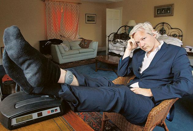 WikiLeaks founder Julian Assange is seen with his ankle security tag at the house where he is required to stay