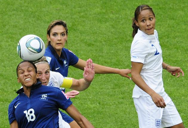 France striker Marie-Laure Delie (18) and midfielder Louisa Necib vie for the ball with England's Faye White
