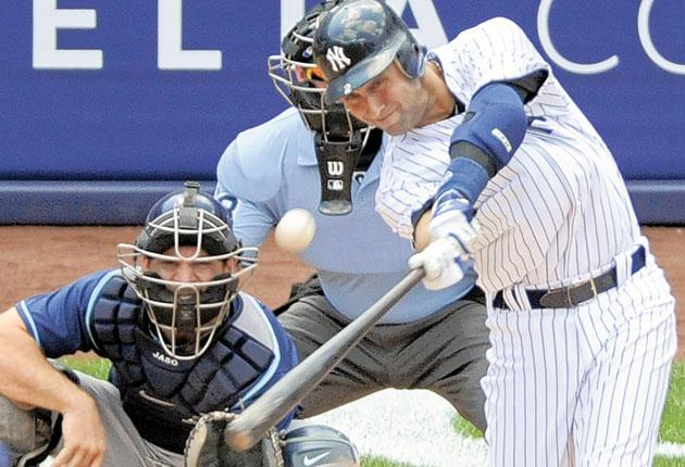 Derek Jeter hits a home run at Yankee Stadium to move to 3,000 career hits on Saturday