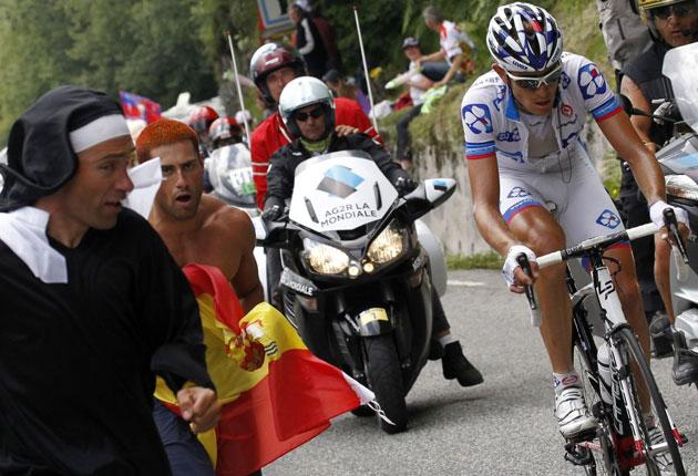 A 'nun' gives chase as France's Jérémy Roy goes it alone on yesterday's 13th stage
