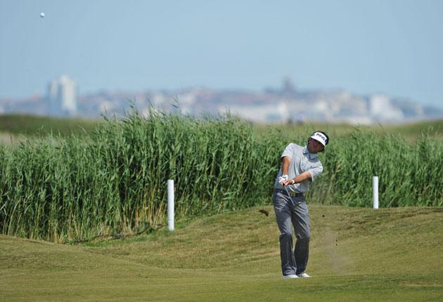 Bubba Watson, the zaniest of the 'mad Americans', chips on to the 14th hole