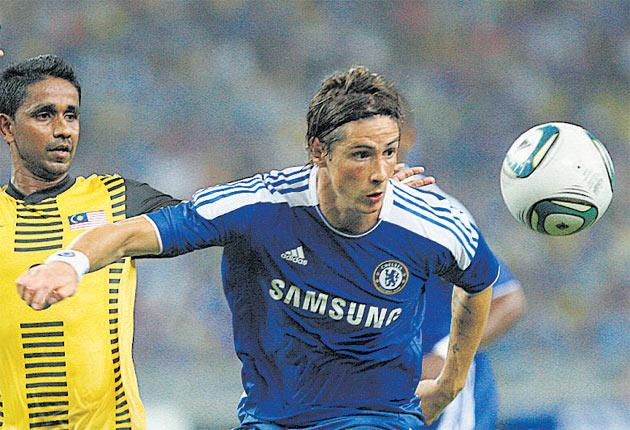 Chelsea's misfiring striker Fernando Torres was off target again during a friendly with a Malaysian XI in Kuala Lumpur last night, but Chelsea did win 1-0