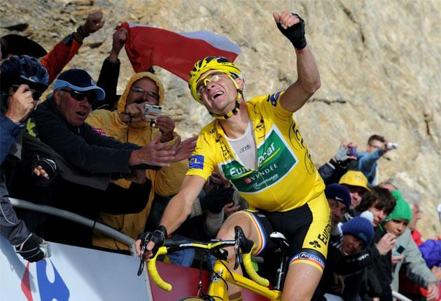 Overall leader Thomas Voeckler shows the pain and pleasure of reaching the finish line on the 18th stage