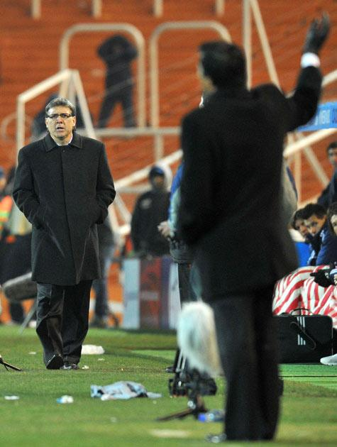 Gerardo Martino (left) will watch the final from the stands