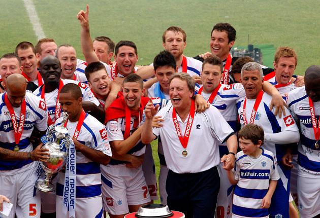 Wayne Routledge (with Championship trophy), Adel Taarabt and Neil Warnock celebrate their title in May