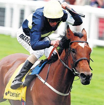 Rising star: Nathaniel is urged on by former champion apprentice William Buick