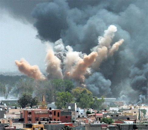 Nato planes bomb a Gaddafi compound in Tripoli last month. Air strikes by allied forces have become increasingly ineffective